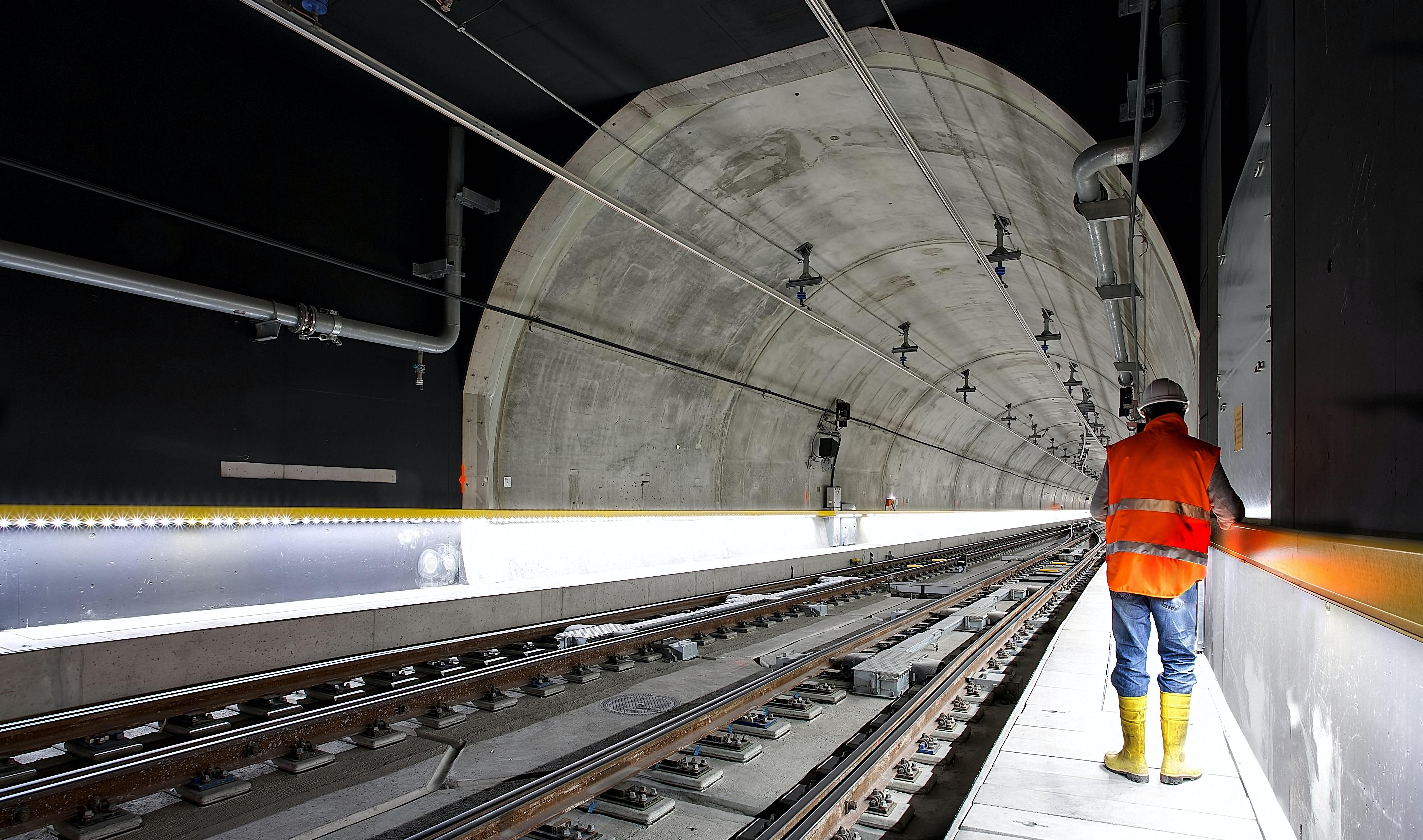 Underground rail tunnel with worker.